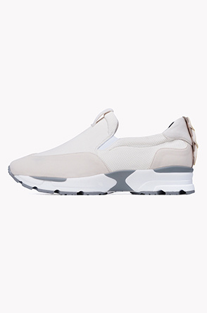 Circle heel tab slip on sneakers