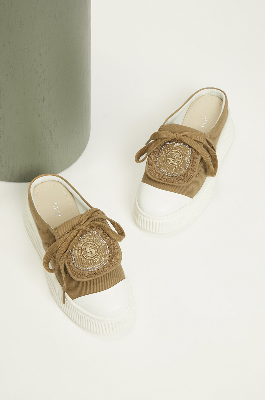 patch flap sneakers mules